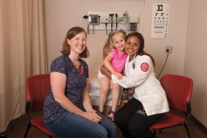 Nursing student with patient and mother