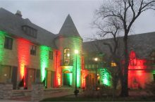 Ewing Manor with red and green spotlights shining from the grounds.