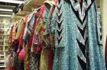 Glittery costumes hanging on a rack