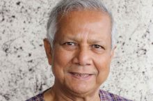 professor Muhammad Yunus smiling for the camera