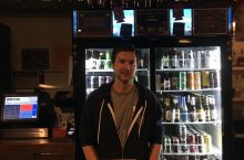 Man standing in front of refrigerator