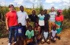 Robert Esterquest and his brother visiting his host family from training in Zambia.