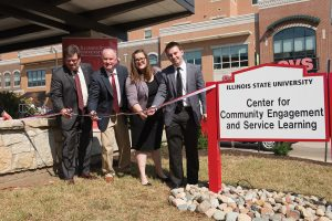 Four people cut ribbon for the Center for Community Engagement and Service Learning