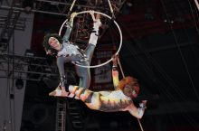 two people suspended in air by hoop
