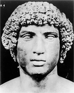 photo of a carved bust of a Roman athlete