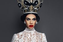 Naomi Smalls wearing top of intricate lace and a bejeweled crown