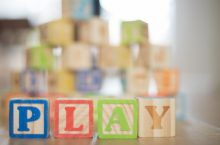 Play-based Instruction with children's blocks forming the word play
