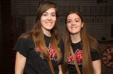 two woman smiling in ISU tshirts