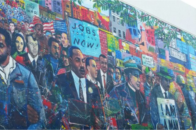 image of a mural filled with civil rights leaders and social justice advocates