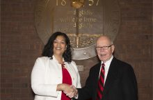 Doris Houston and David Strand standing in front of the old ISU seal in the Bone Student Center