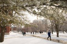Students walking on snowy Quad