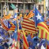 Crowd supporting Catalonia's Independence Movement with flags and marching