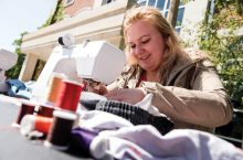 Volunteer Paulina Wietocha has been sewing for years; her grandmother was a seamstress in Poland.