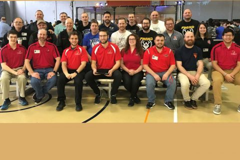 Technology and Engineering Collegiate Association members and former alums at Robot Rumble