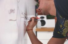 community partner man writing on whiteboard