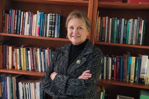 Lynne Haeffele standing in front of bookcase