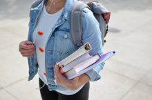 girl with backpack and books