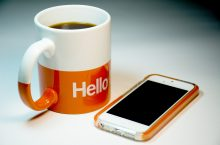 cup of coffee and cell phone
