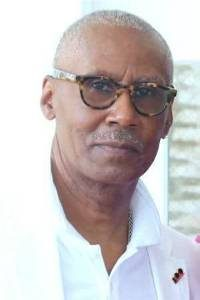 headshot of Craig Gilmore wearing glasses