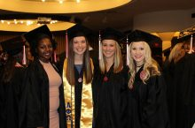Four MCN Students in caps and gowns