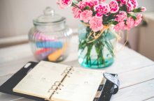 flowers and calendar on desk