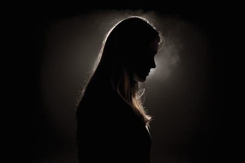 Woman pictured in shadows