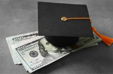 Mortar Board placed on hundred dollar bills