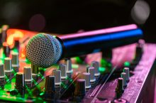 Microphone sitting on a soundboard under dance lights