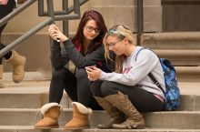 Students use their cell phones to access Linkedin