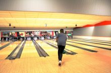 An Illinois State student bowls at Sunday Funday.