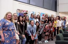 Students with art exhibition.