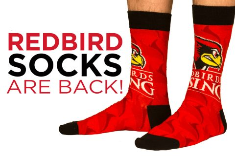 photo of someone's feet wearing socks featuring the Redbirds Rising logo.