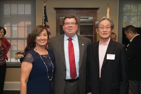President Larry Dietz with Anna Wei, M.S. '73, and her husband, C.P. Koa.