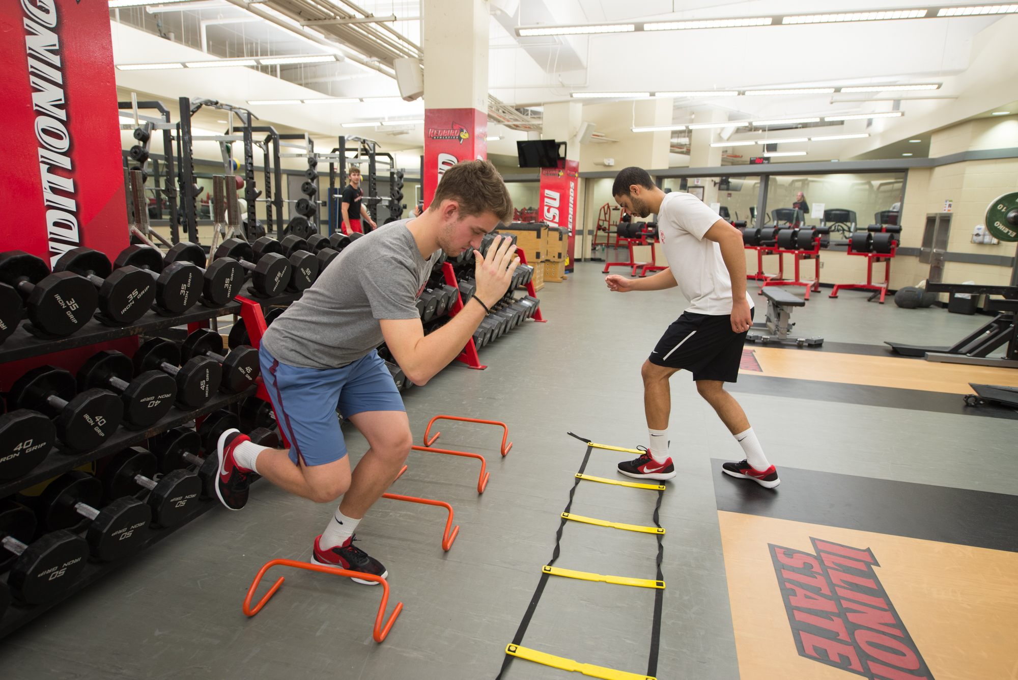 Manuel Bernhard and Cameron Petersen working out in the Owen Strength and Conditioning Center