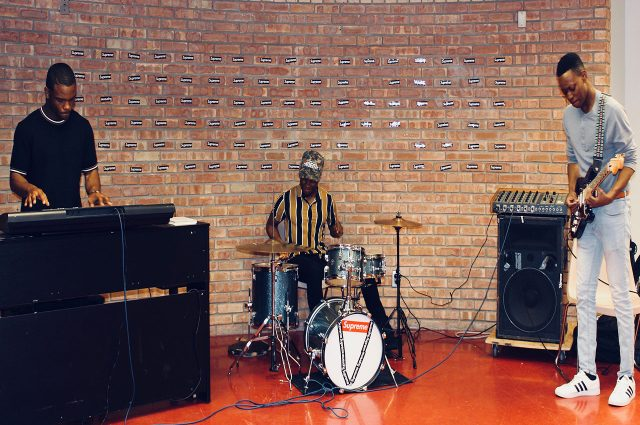 VisionMade, a band formed by Justin Pickett, Antonio Crossley and Tobi Taiwo (left to right) practice the keyboard, drums and guitar in the basement of Hewett hall.