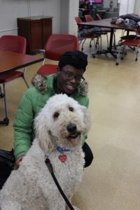 Student with therapy dog Bubba