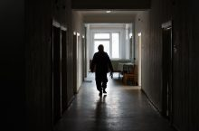 Patient walks down hallway.
