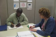 Regan and Cindy, project READ participants, work through a one-on-one math lesson.