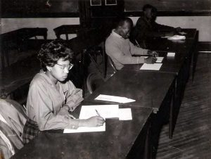 Anne Wortham at desk, black and white photo