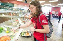 A student grabs food at Linkins Dining Center on campus.
