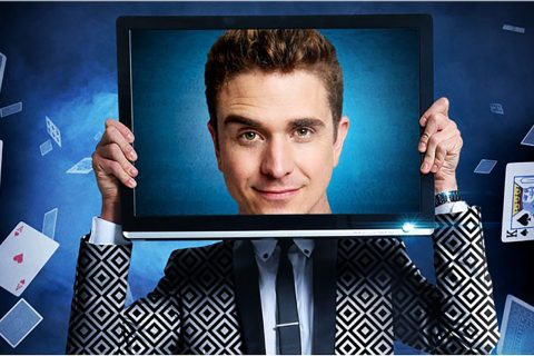 Man holding a TV screen with his face on it