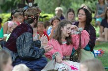 Image of three actors performing a scene for Illinois Shakespeare Festival's Theatre for Your Audiences