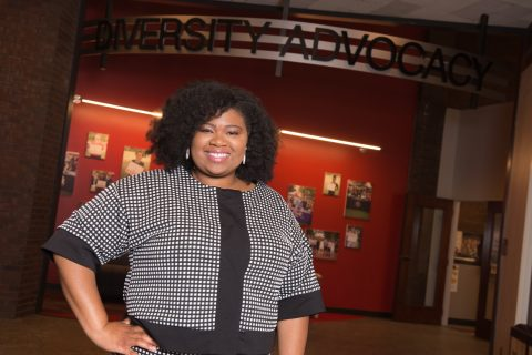 Christa Platt, standing outside the Diversity Advocacy Office in the Bone Student Center of Illinois State University