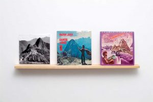 "Imaged of william cordova's work BALSA, 2008. Rephotographed photo of ""Machu Picchu"" by Martin Chambi (1929), Victor Jara's ""Canto Libre"" LP (1973), and Herbie Hancock's ""Thrust"" LP (1974) on custom Bolivian balsa wood shelf. Courtesy of the artist and Artpace, San Antonio."