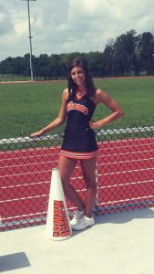 Tristen Sharp as a high school cheerleader