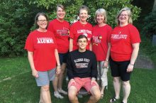 The Hynd sisters include, from left, Mary Schrock '82, Eileen Saksa '84, Patricia Scott '86, Karen Fitzgerald '88, and Janet Gibson '91. Seated is Patricia's son, Alex, beginning his sophomore year. Not included are Cliff Schrock '81 and Christopher Saksa '16.