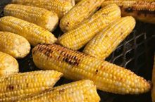 Locally grown corn on a grill