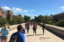 Students on campus bridge