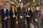 photo of several students in business suits