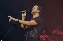 Luke Bryan singing on stage